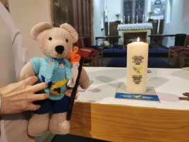 Tedi Su with pilgrimage candle